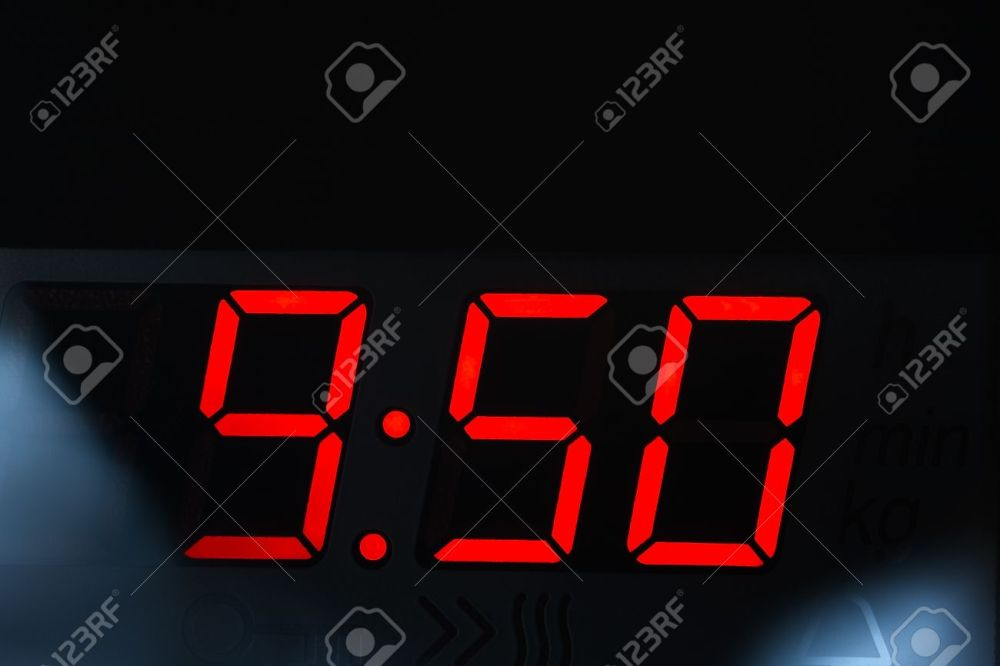 Close-up-of-a-clock-display-from-modern-microwave-oven-Hdr-image--Stock-Photo